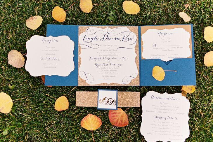 "The Fancy Envelope helped create Margaret and Ryan's mountain-themed invitation suite. ""We wanted the invitations to have a Colorado feel. We had the outline of the mountains on the band that went around the invites. The navy and gold invitations were a great introduction to the theme and wedding colors,"" Margaret says."