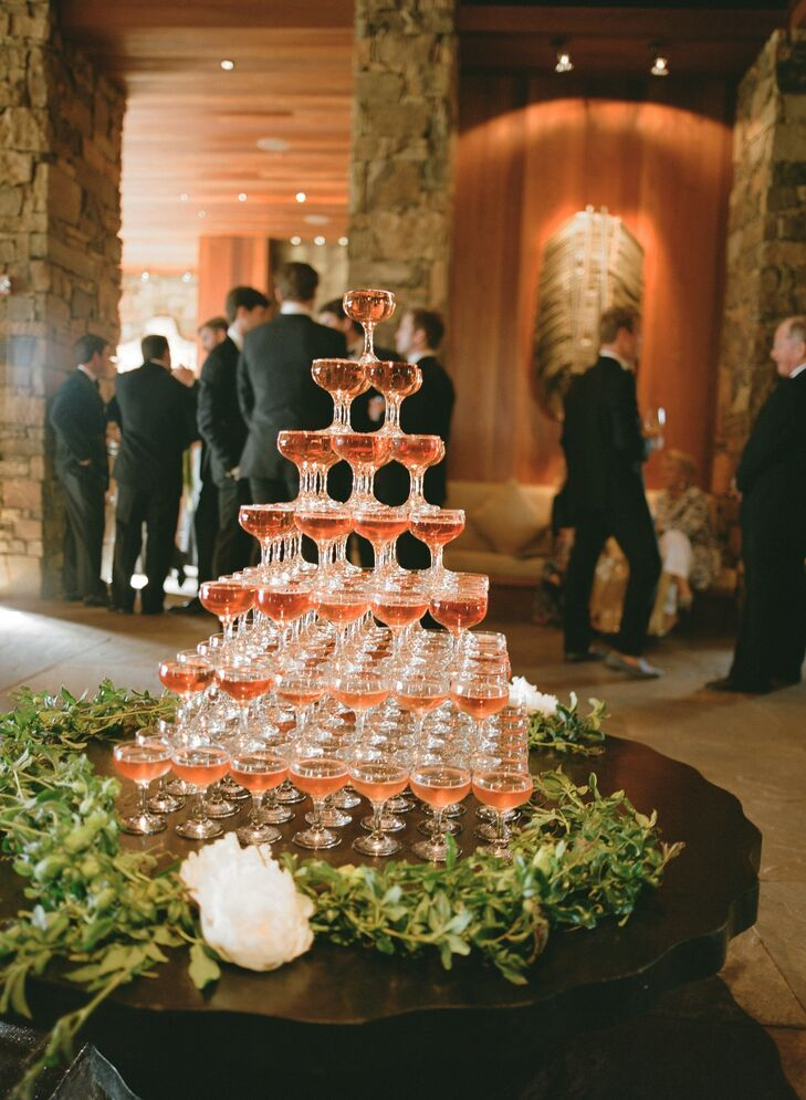 As guests entered the upstairs lobby at the reception, they were greeted by a lavish champagne tower. In the center of the rustic mountain venue, the tower added a level of elegance and sophistication.