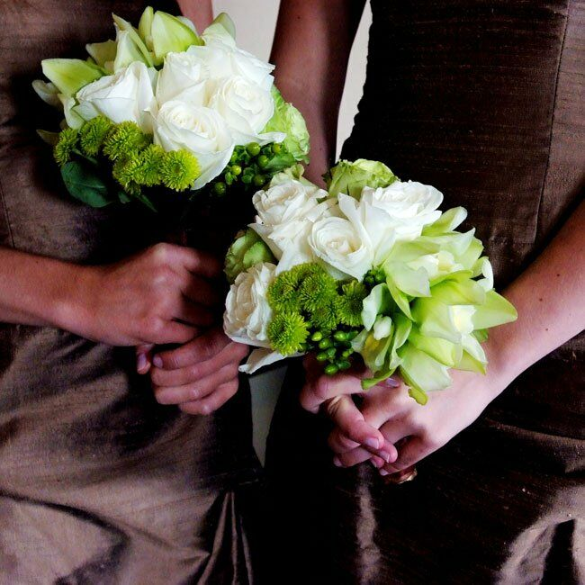 The bright green and white bridesmaid bouquets were filled with button mums, orchids, roses, and hypericum berries.