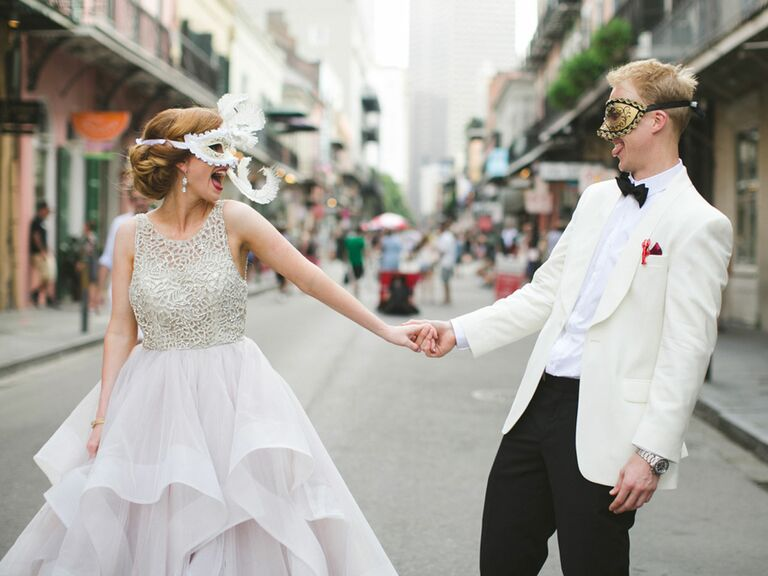Newlyweds in in mask in street of New Orleans