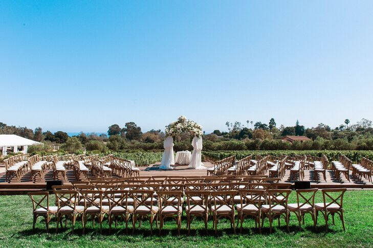"""""""The ceremony chuppah was raised up on a custom-built wooden deck that made the ceremony feel more intimate,"""" Alyssa says. """"The seats were set up in a semicircle around us, which I highly recommend for shy brides."""""""