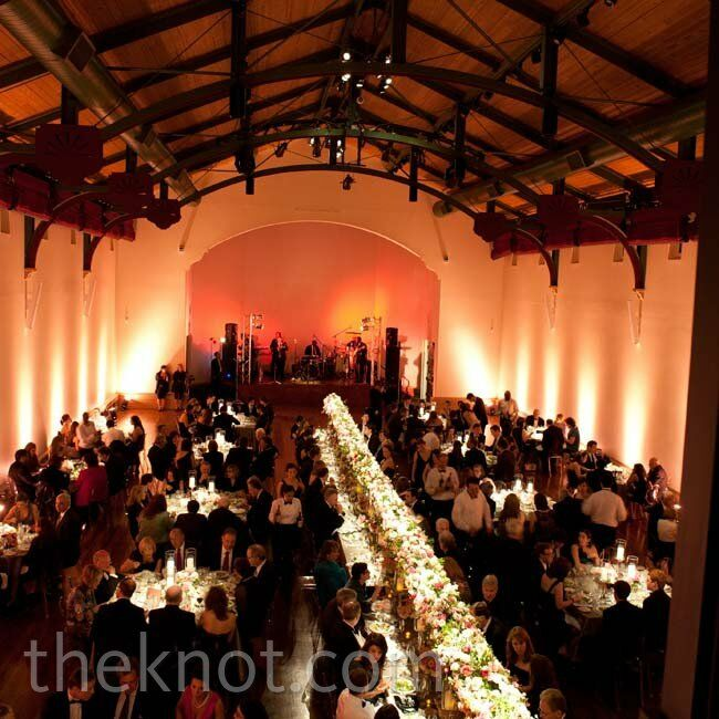 Candles and warm uplighting around the perimeter of the room made the large space seem cozy.