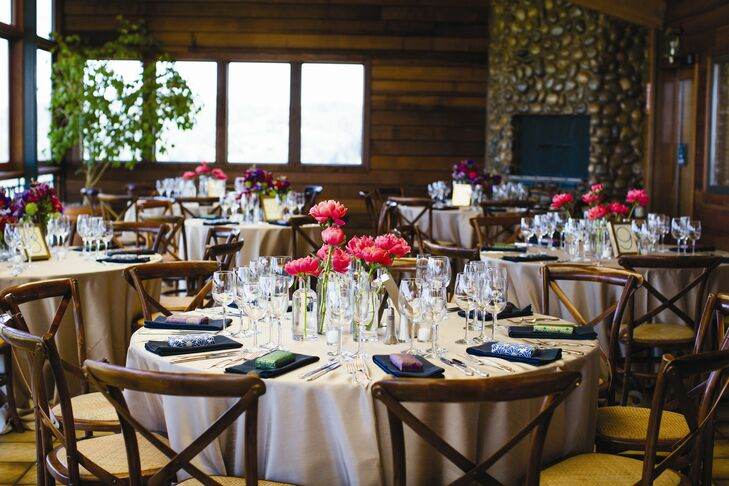 The elegantly simple table settings featured champagne tablecloths, navy napkins and clear bottles filled with single stems of peonies.