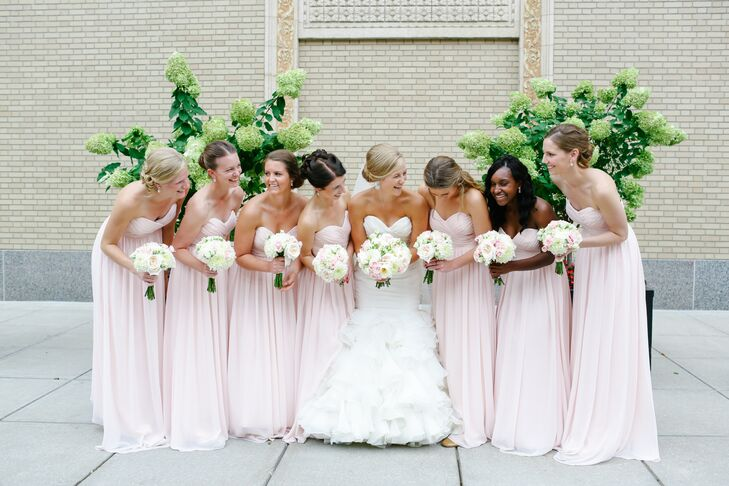 The bridesmaids wore pale pink floor-length strapless dresses by Bill Levkoff with jewelry from J.Crew.