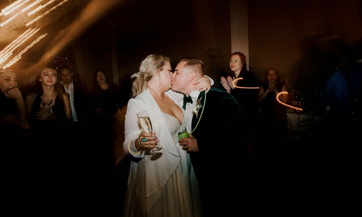 Couple Shares Kiss During Wedding at The Space HTX in Houston, Texas