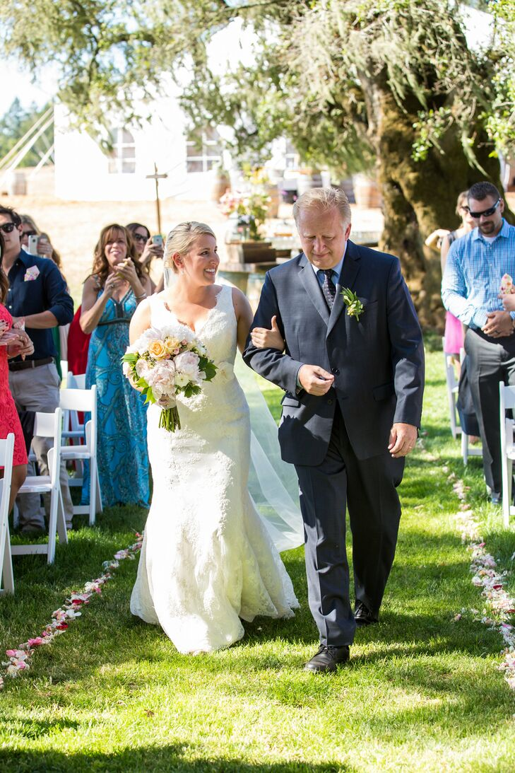 """Allyson was led by her father down the grassy, rose-petal aisle to the shady spot under a majestic old tree where she would say """"I do."""""""