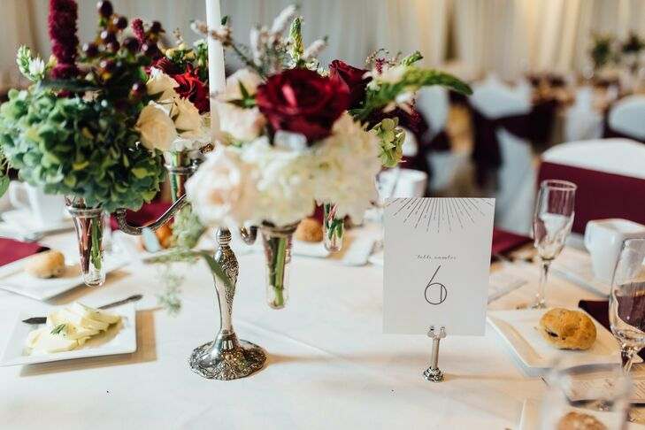 """We wanted something simple, silver and geometric to play off the art deco elements in my dress,"" Elizabeth says of the couple's stationery. The pair found the perfect fit for the occasion on Minted.com, which they used for the invitations and the reception stationery, including table numbers and escort cards."