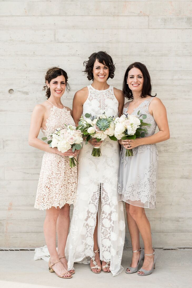 Marie requested only that her two bridesmaids choose short dresses in warm, neural tones that complemented her gown's lace texture.