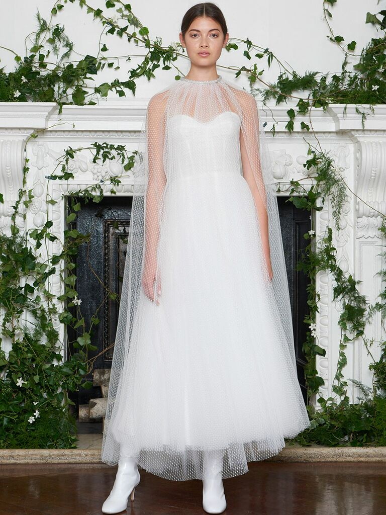Monique Lhuillier Fall 2018 ankle-length sweetheart wedding dress with fishnet cape