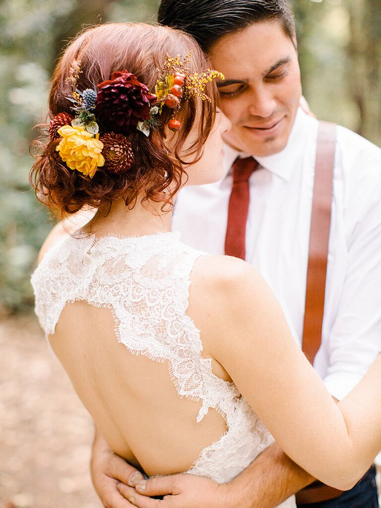 Messy bun wedding hairstyle with flowers