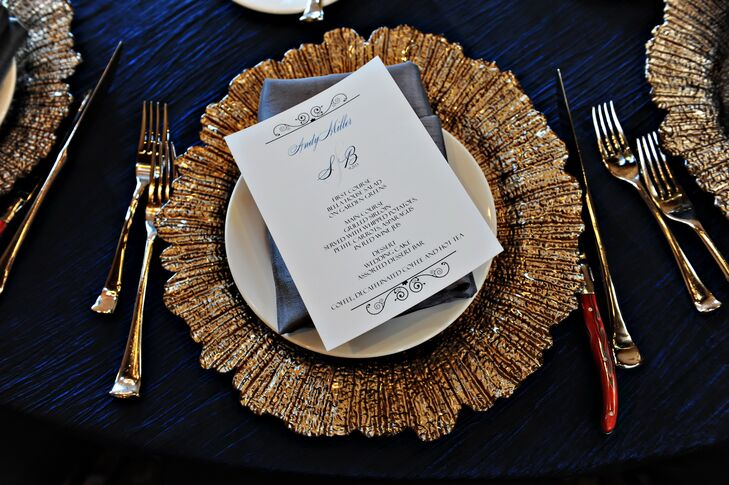 The wedding's stationary followed the couple's navy and silver color palette and much of the decor featured elements that added to the iron work of the venue.