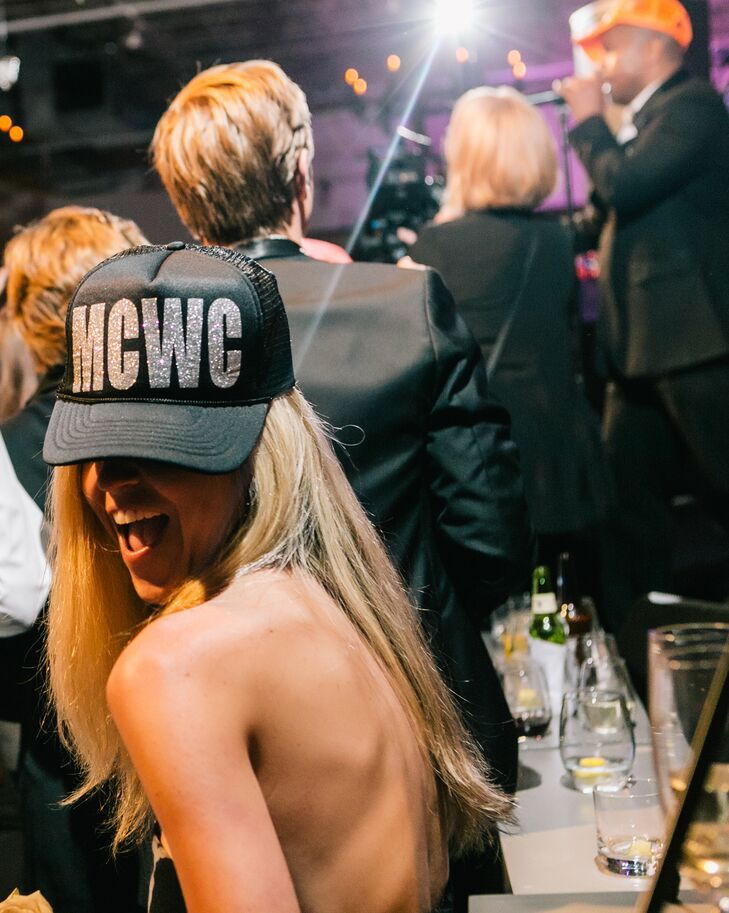 "A unique party favor from the wedding was the ""MCWC"" hats, created by The Shirt Place, which guests wore while they danced to the tunes from Atlanta Showstoppers."
