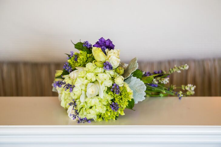 Liz held a bouquet of hydrangeas, roses, lavender and button mums. The purple and green hand tied bouquet popped against Liz's champagne and ivory wedding dress.