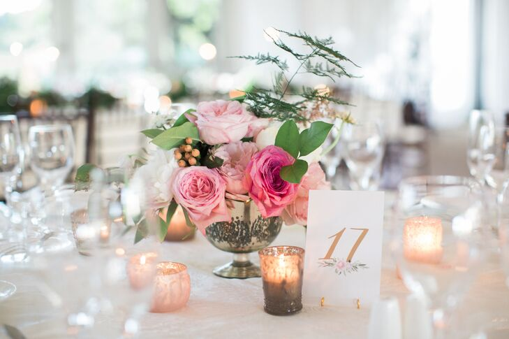 Rye Workshop created two different centerpieces for the reception, a mix of small and large floral arrangements featuring blush, pink, white and ivory blooms styled alongside candlesticks, and mercury-glass votives that popped against a sea of refined white linens.