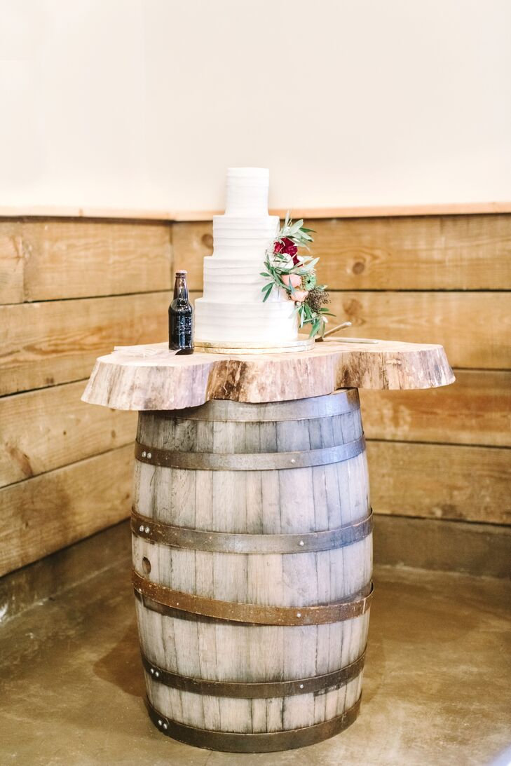 Rick's Bakery provided a plain, white tiered cake for the reception, which is the kind of simplicity Lydia craved.