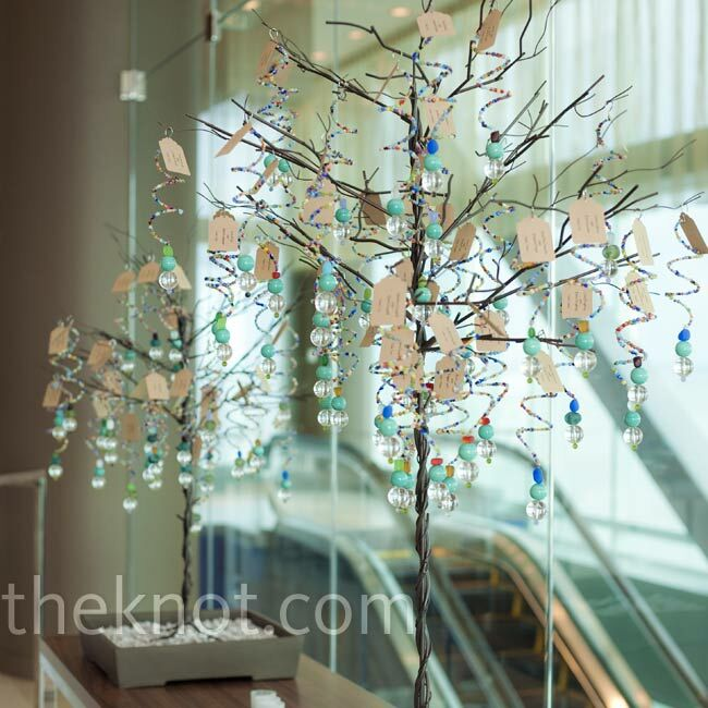 Shey and Ryan threaded recycled glass and sea glass beads onto wire and tagged each ornament with seating assignments.