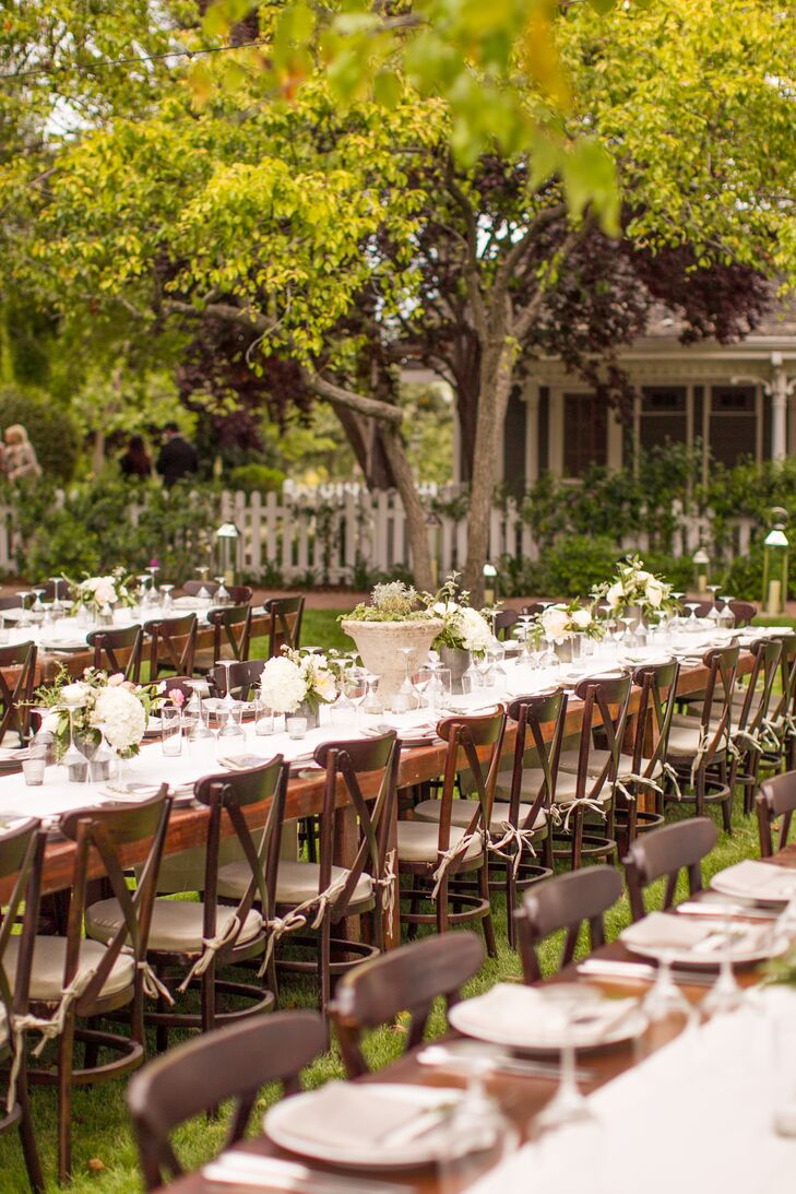 The family-style tables were matched with vineyard cross-back chairs and numbered with potted herbs.