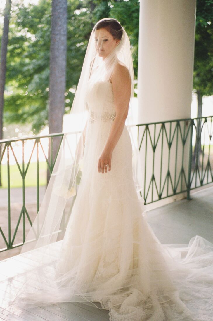 """My dress was a head-to-toe Spanish lace mermaid fit with a sweetheart neckline and rhinestone belt,"" says Memorie. ""It was the opposite of what I originally set out for but when I tried it on, I could just feel that it was the one!"""