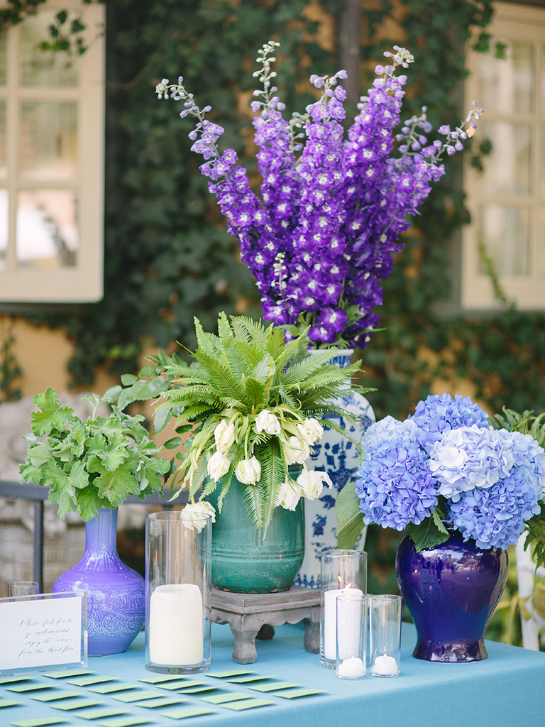 purple and violet flower table arrangements