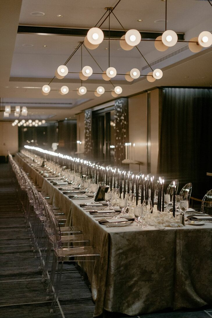 Long Reception Table with Black Taper Candles and Ghost Chairs