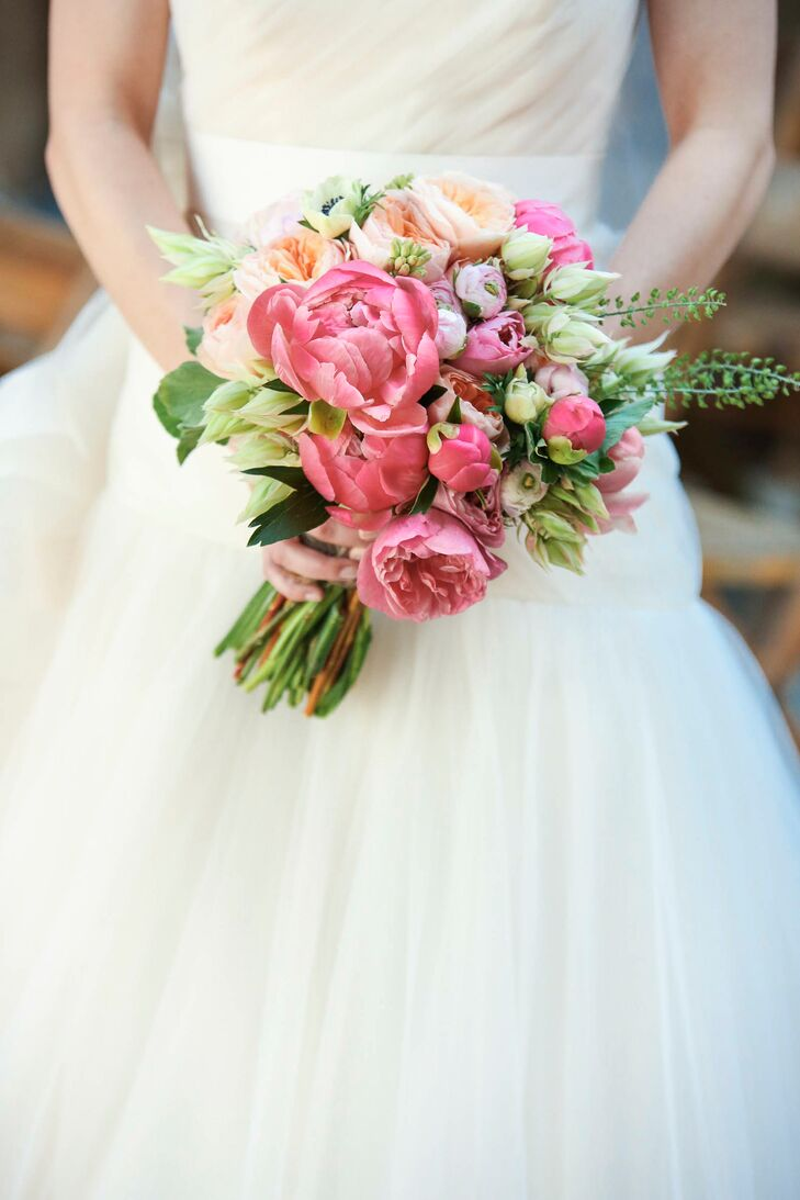 "With peonies being Emma's favorite flowers, the beautiful bloom was bound to make an appearance in the bride-to-be's bouquet. The lush arrangement featured peonies, garden roses, anemones, tulips, ranunculuses and wildflowers for a romantic, yet playful look. ""I love peonies because they have such lush texture and warm color,"" says Emma. ""They embody romance and prosperity and are regarded as an omen of good fortune and a happy marriage!"""