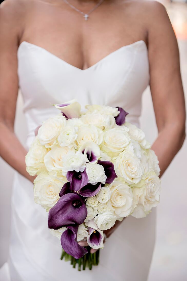 Angela's bridal bouquet of white roses was accented by deep purple calla lilies.