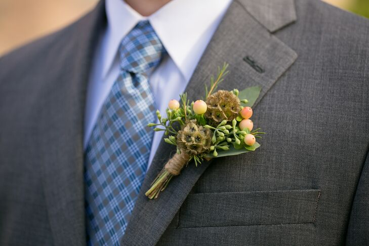 "Roger wore scabiosa pods, hypericum berries and seeded eucalyptus for his boutonniere. ""Cindy Sinclair, venue owner and florist, and I decided to have the boutonnieres made with seed pods and berries instead of flowers since it fit Roger's woodsy personality and worked well with the season."""