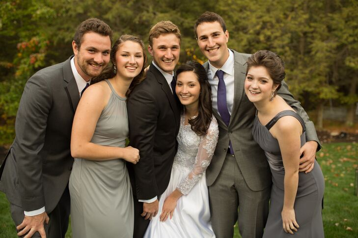 The bridesmaids wore gray dresses in the style and shade of their choice and the groomsmen wore different gray suits.