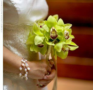 Orchids were the flower of the day, hence Maggie's simple orchid bouquet. Her gown was just as understated yet stylish as the rest of the event. Maggie wore a two-piece Romona Keveza ensemble that teamed a silk-shantung skirt with a lace corset bodice.