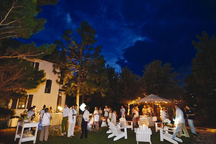 The couple played up their outdoor location with tiny white lights and Moroccan lanterns for a global, bohemian vibe.