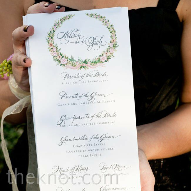 The pink-and-green floral wreath that decorated the programs tied in with the ceremony décor perfectly.