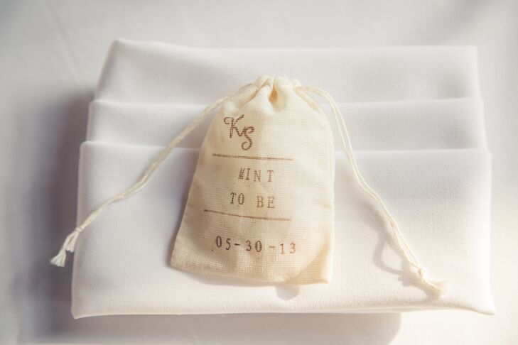 For the favors, the DIY bride purchased muslin bags from muslinbag.com, mints from Party Box, and stamped them with an alphabet rolling stamp from Glassnam on Etsy.
