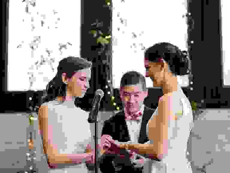 brides exchanging vows during Catholic-Jewish ceremony