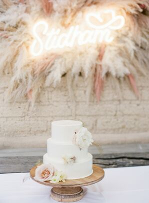 Rustic Tiered Cake with Flowers and Wood Stand
