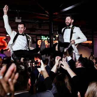 Grooms at wedding reception party
