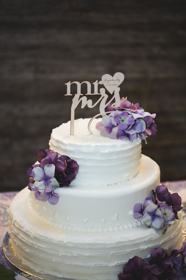 Two Tier White Wedding Cake With Purple Flowers