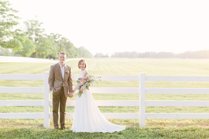 Anna wore an ivory dress with a high illusion neckline and a long train that draped behind her. Anna held a blush bouquet filled with pink peonies and leafy greens.