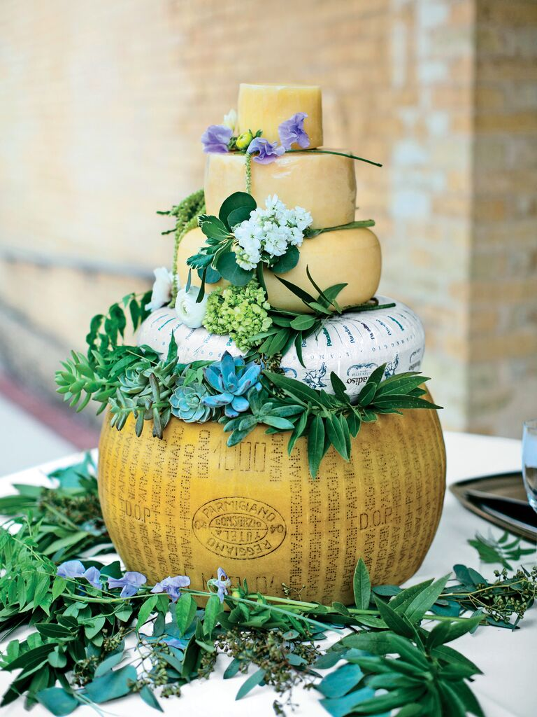 stacked wheels of cheese instead of wedding cake