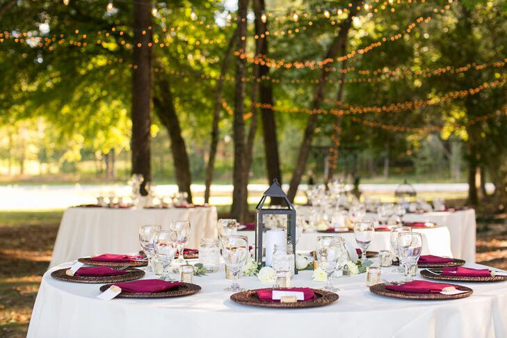 "The rustic centerpieces varied from lanterns to wooden boxes finished by the bride and her mother. ""For our decor, we bought and built locally, as our families value local businesses and do our best to support our community,"" says Victoria."