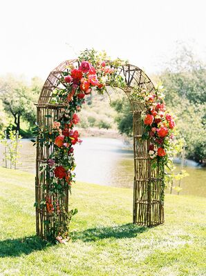 Rustic Ceremony Arch with Pink Flower Arrangements