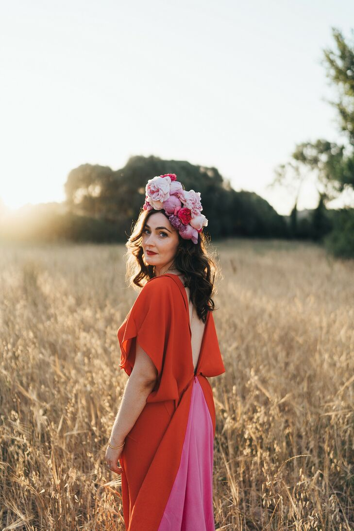 Bride in Red Dress and Pink Flower Crown Walking Through Field