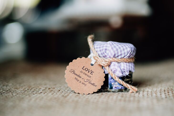 """As wedding favors, Heather and Brendan gave their guests small jars of grape jelly. The jars were tagged with a label reading """"Love Is Sweet."""""""