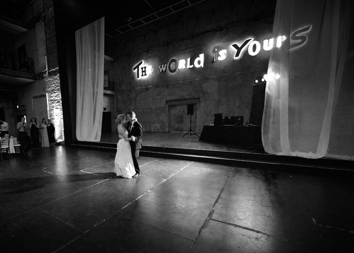 Jodi and Steve shared their first dance under the loft's colorful, light-up sign.