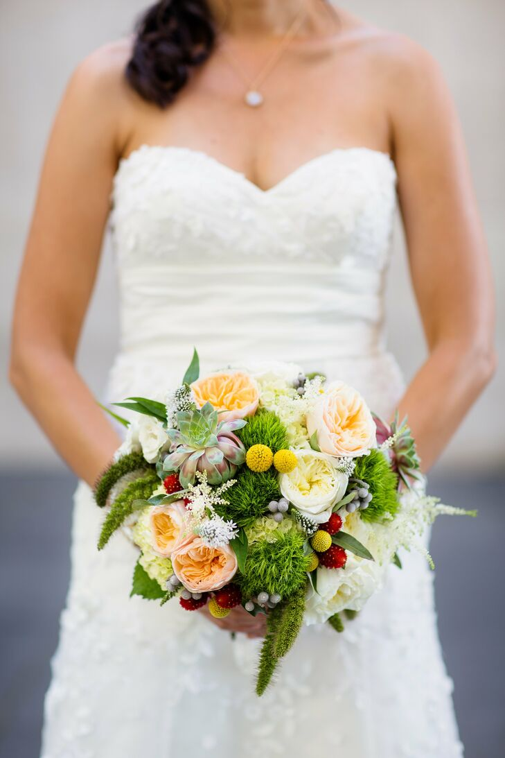 Christine was very particular about her bouquet; she wanted it to be artsy and nontraditional. Her eclectic mix of succulents, billy balls, garden roses and trick carnations was wrapped with wedgewood-colored ribbon.