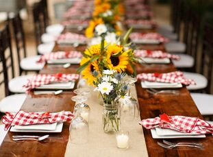 Paige and John love the country and outdoors so it was only natural to hold their rehearsal dinner outdoors at Paige's family home. Handmade wooden fa