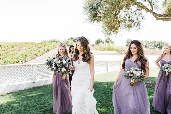 Bridesmaids with Purple Gowns and Down Hairstyles