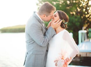 Whitney Zigich (28 and an actuary) and Ryan Powell (28 and a medical sales representative) planned a fun, beachy affair at the Drop Anchor Resort in I