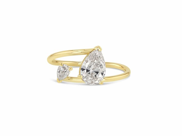 two stone ring in yellow gold setting with larger pear shaped diamond and smaller pear shaped diamond
