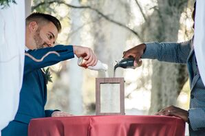 Grooms Pouring Sand into Vase for Unity Ceremony