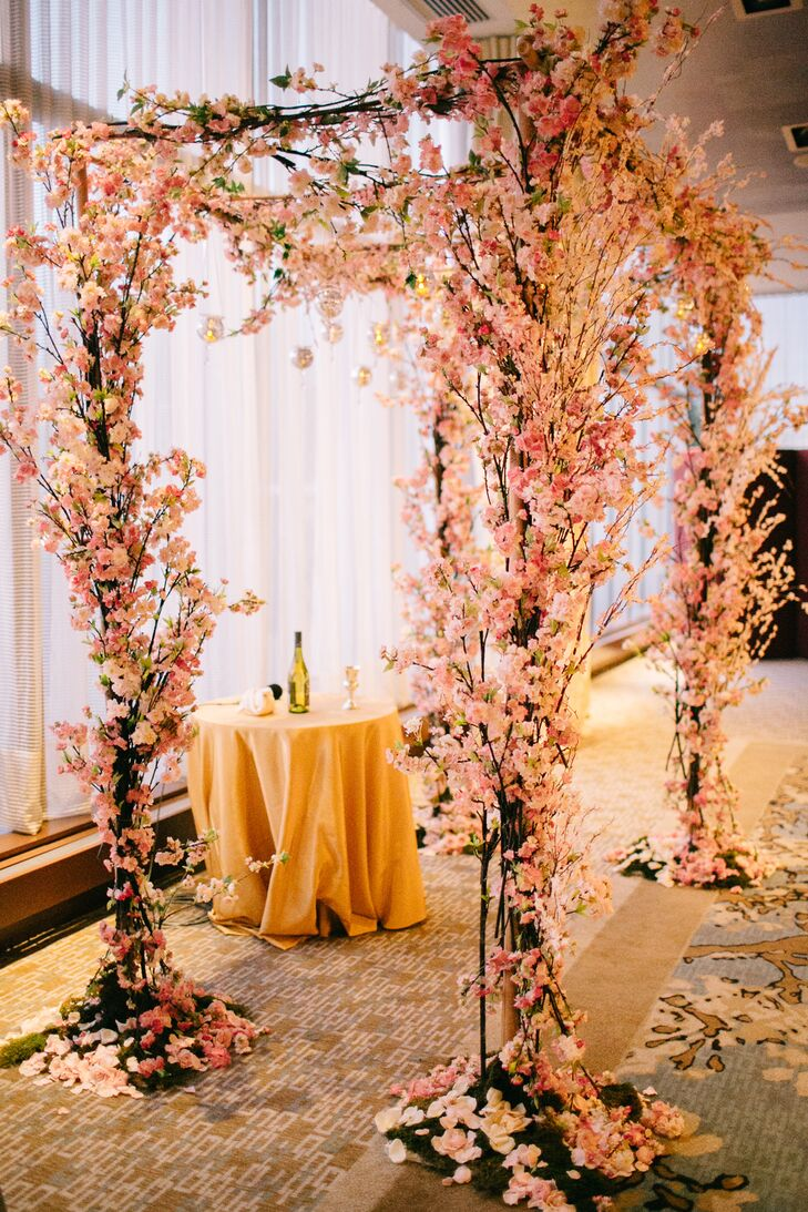 "Marissa and Alex wanted the overall vibe of their wedding to be bohemian chic. ""I wanted everyone to feel like they were in the Garden of Eden, which was reflected in our chuppah,"" Marissa says. The wooden arbor was decorated with pink blossoms, moss and hanging terrariums for a stunning backdrop for their vows."